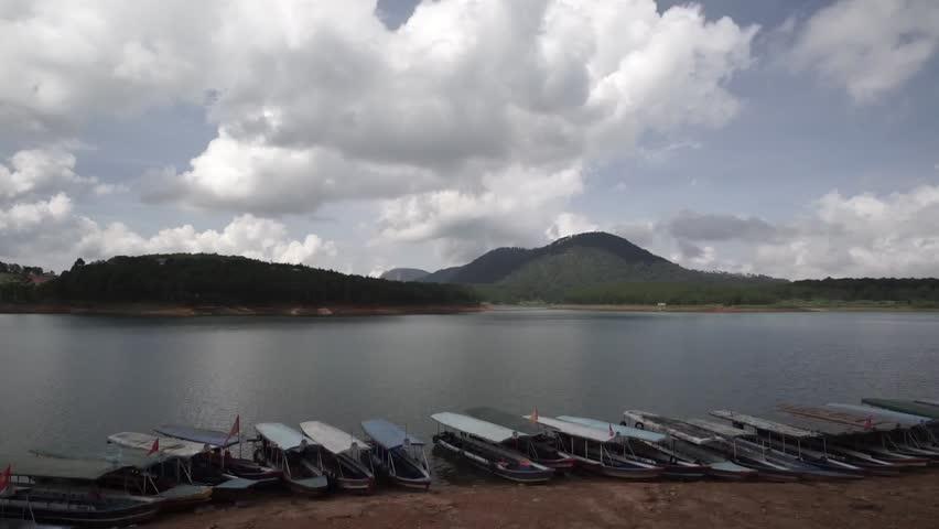DA LAT, VIETNAM, Sep 23, 2015: Tranquil landscape of Dalat city, apart of Ho Xuan Huong lake in Dalat, Viet Nam | Shutterstock HD Video #25002836