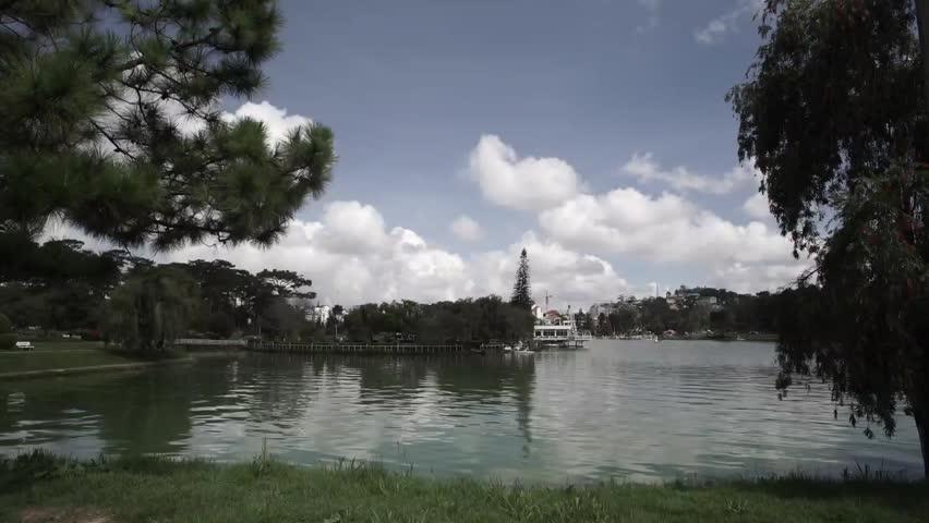 DA LAT, VIETNAM, Sep 23, 2015: Tranquil landscape of Dalat city, apart of Ho Xuan Huong lake in Dalat, Viet Nam | Shutterstock HD Video #25002854
