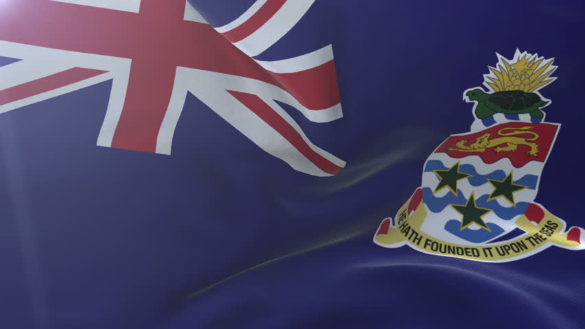 Flag of Cayman Islands waving on flagpole in the wind, national symbol of freedom. Traditional flag symbolizing the pride of nation, love for motherland, patriotic feelings toward country, native land