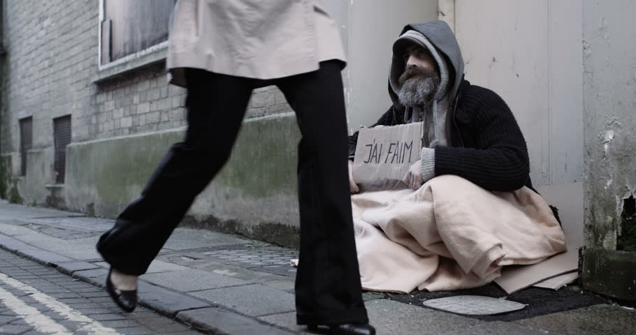 4k, A homeless man holding a sign | Shutterstock HD Video #25028450