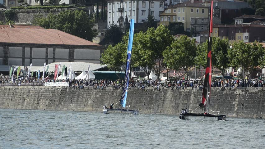 PORTO, PORTUGAL - JULY 07: Participants compete in the Extreme Sailing Series boat race on july 07, 2012 in Porto, Portugal. - HD stock footage clip