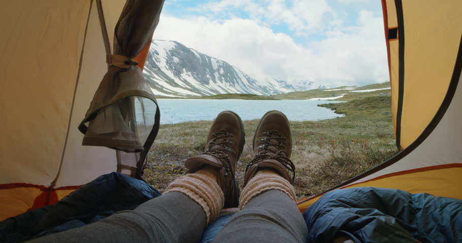 Camping woman lying in tent Close up of Girl feet wearing hiking boots relaxing on vacation POV | Shutterstock HD Video #25063172