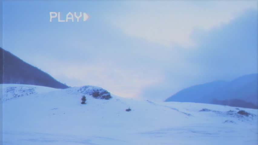 Fake VHS tape: morning or dusk on a mountain full of snow.