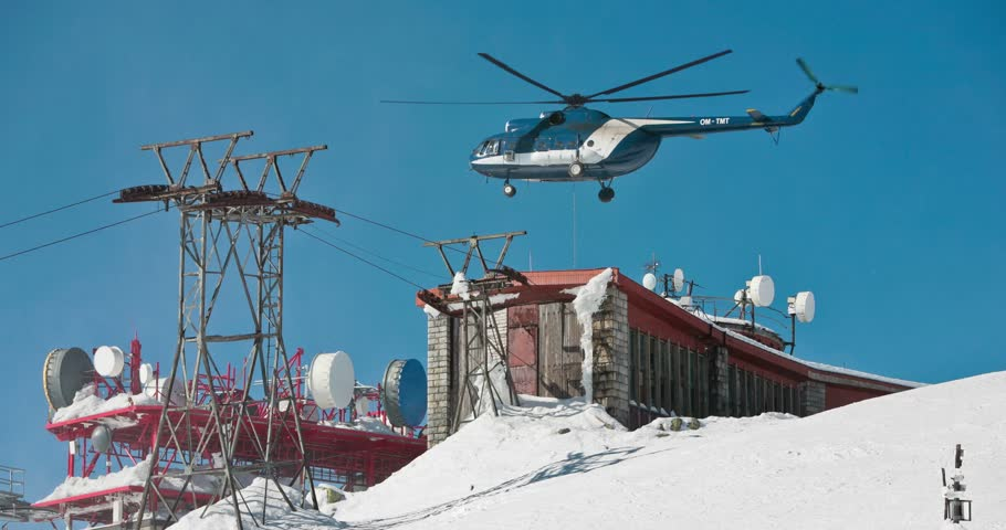 Helicopter under the radio weather station on top of mountain. Looping cinemagraph.   Shutterstock HD Video #25082243