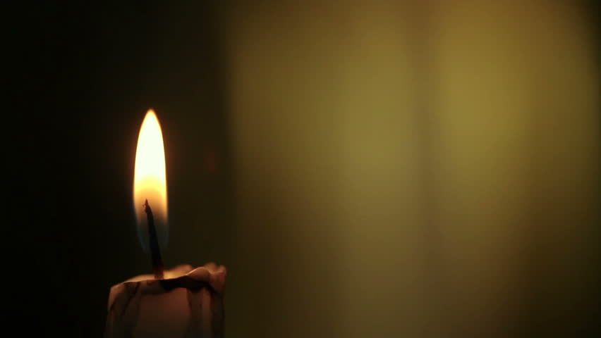 candle lights up and being blown out slowly stock footage