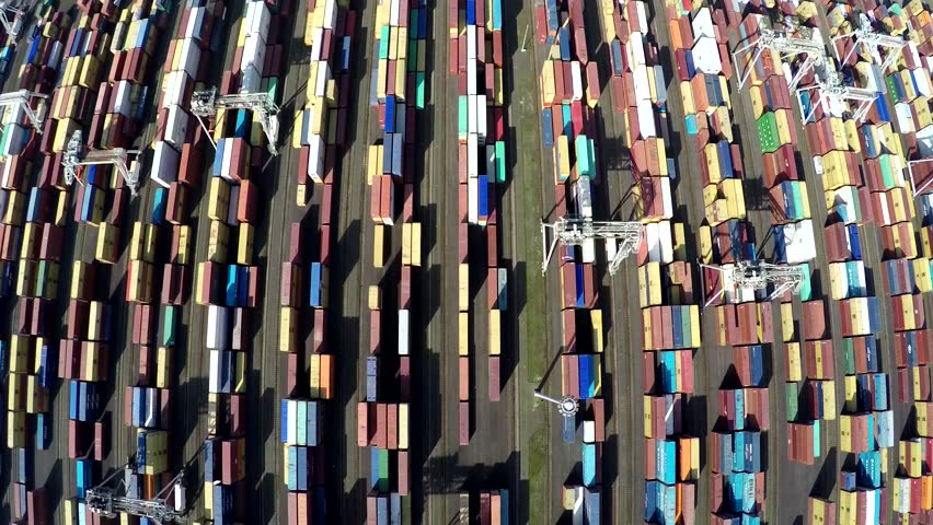 Aerial top down view of container terminal intermodal container is standardized shipping container designed and built for intermodal freight transport are used across different modes of transport 4k   Shutterstock HD Video #25113077