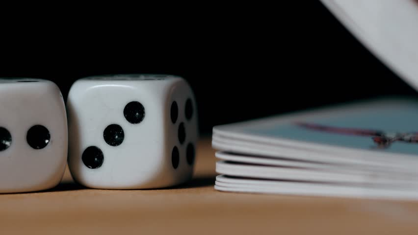 Playing dices and cards on a wooden table super close up macro on black background | Shutterstock HD Video #25138475