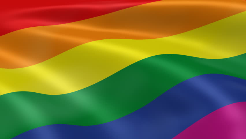 Gay rainbow flag waving in the wind in a clear