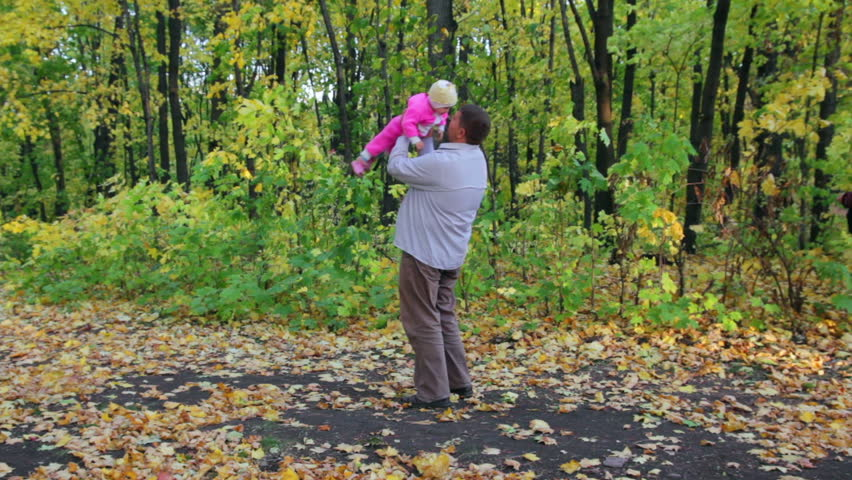 father playing with baby in autumn park - HD stock footage clip
