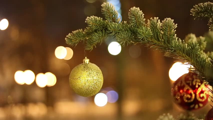Christmas Decorations on Frozen Fir Tree Branches. Holiday evening/Christmas Decoration on Frozen Fir Tree Branches.  | Shutterstock HD Video #25170506