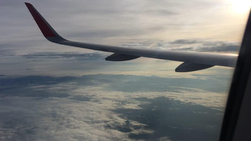 Traveling by air. View through an airplane window.View of clouds through airplane window. | Shutterstock HD Video #25182656