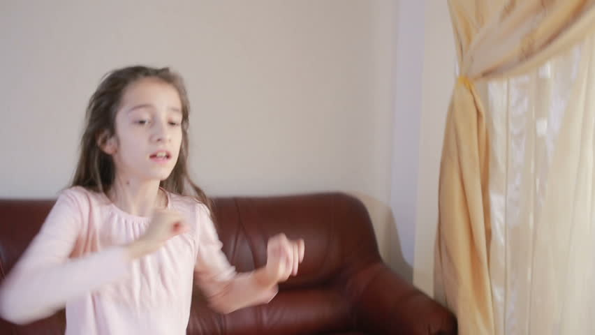 Little cute girl dancing and fooling around at home | Shutterstock HD Video #25183538