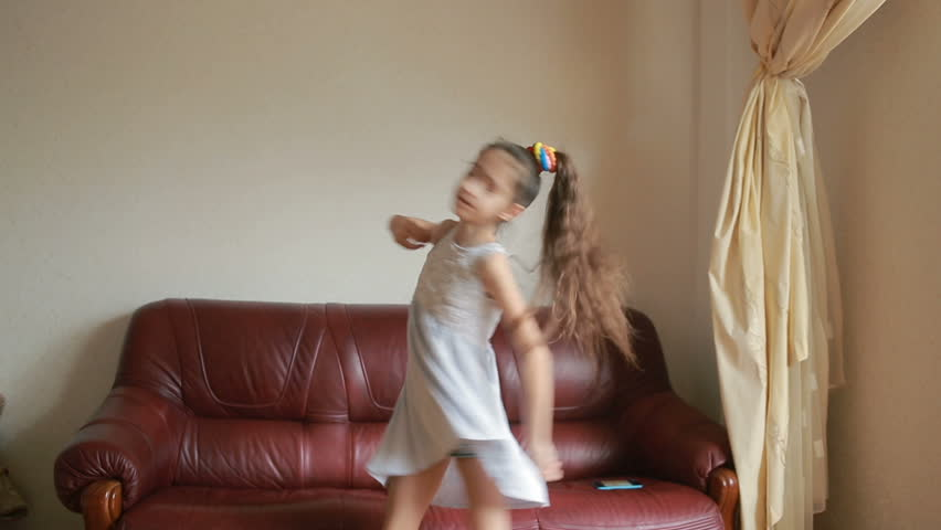 Little cute girl dancing and fooling around at home | Shutterstock HD Video #25183547