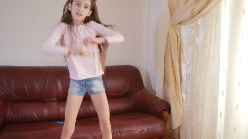 Little cute girl dancing and fooling around at home | Shutterstock HD Video #25183556