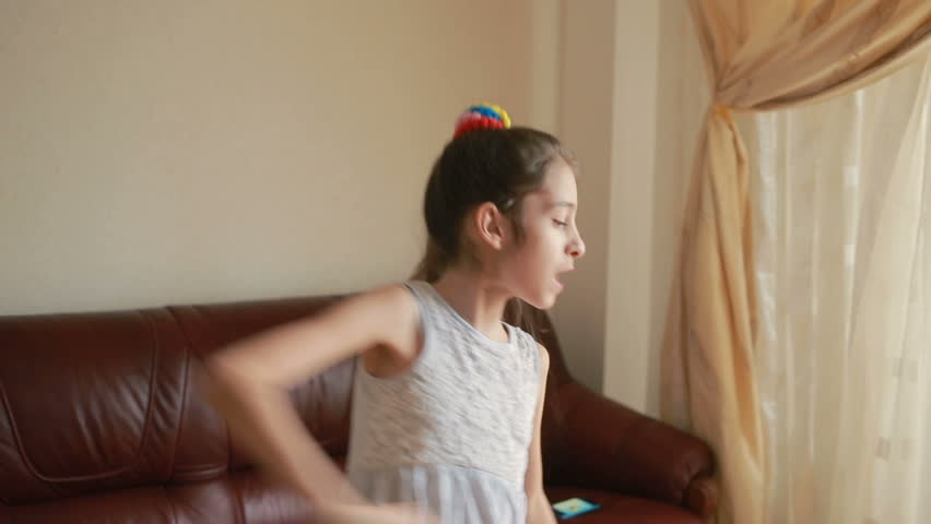 Little cute girl dancing and fooling around at home | Shutterstock HD Video #25183565