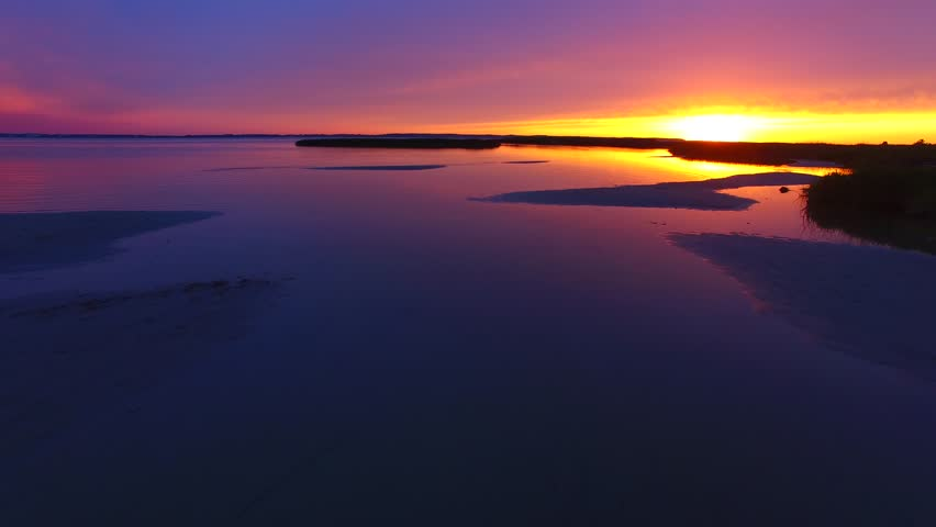 Drone view of wonderful evening with colorful shot over the lagoon. Svencele, Lithuania | Shutterstock HD Video #25184411