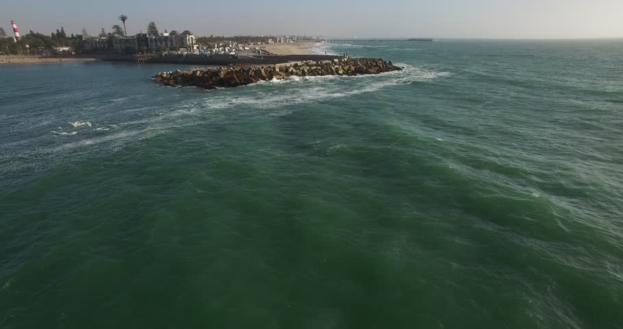 Drone video of view of Namibian Atlantic coastline, Swakopmund town buildings, beach, old pier, surf break point and landscape of ocean background of Swakopmund holiday resort at Namibia's west coast | Shutterstock HD Video #25185842