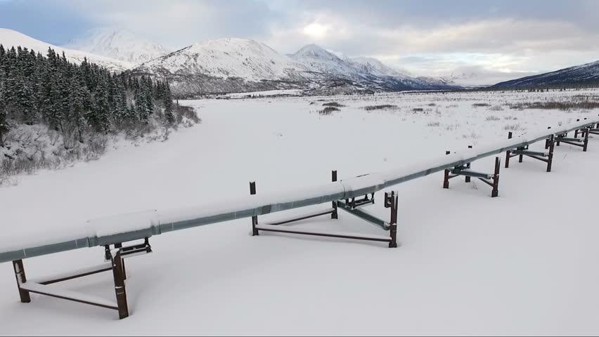 Oil Transport Alaska Pipeline Cuts Across Rugged Mountain Landscape   Shutterstock HD Video #25217756
