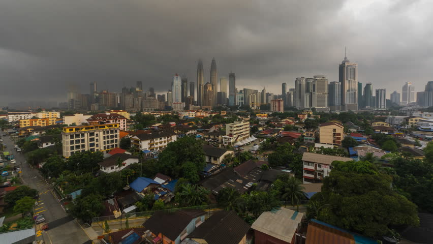 4k time lapse of dramatic weather scenery at Kuala Lumpur city. Moving and changing color clouds. Aerial view. | Shutterstock HD Video #25222031