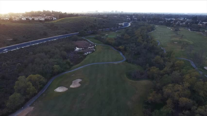 Amazing sunset at a golf course aerial drone shot | Shutterstock HD Video #25228763