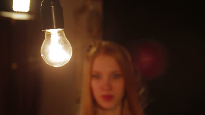Woman fashion model and lighting bulb | Shutterstock HD Video #25233911