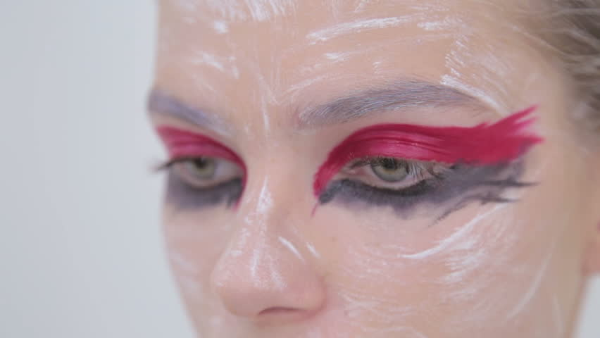 Eye shadow painting: professional make-up artist making face makeup art. Make up, visage and fashion concept | Shutterstock HD Video #25234685