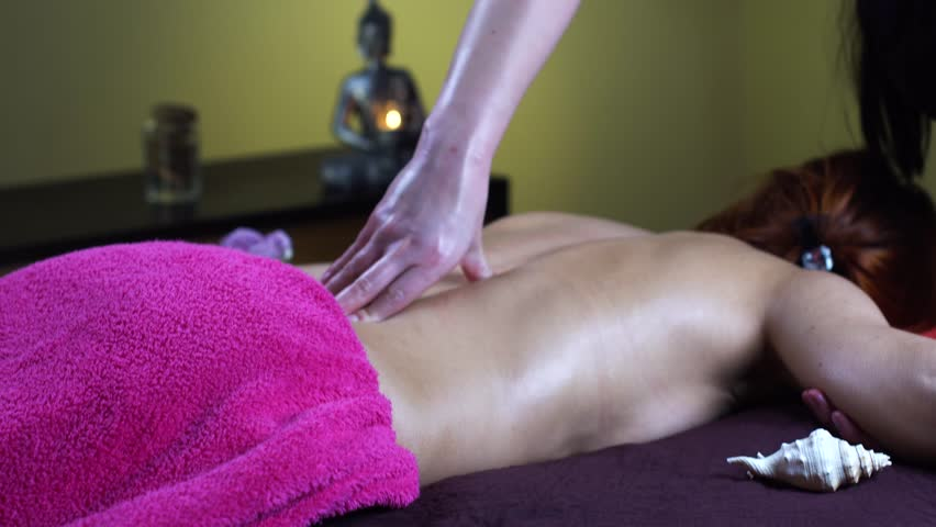 Young woman reciving relxing massage   Shutterstock HD Video #25239572