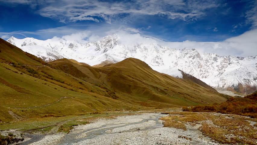 Fantastic white massif. Gorgeous scene. Location place Ushguli, Mt. Shkhara, Svaneti, Georgia country, Europe. Caucasus ridge. Climate change. Explore the world's beauty. Shooting in HD 1080 video. | Shutterstock HD Video #25244360