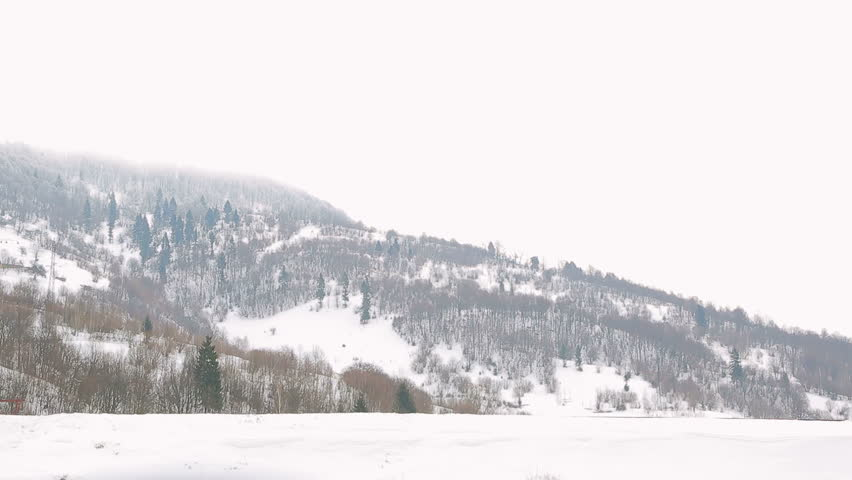 Train on the background of winter mountains | Shutterstock HD Video #25251965