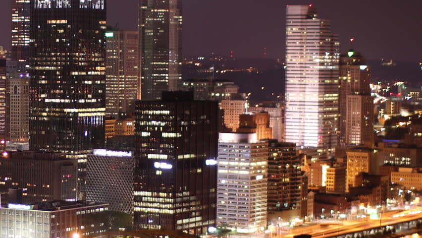 Dramatic nighttime time lapse shot of Pittsburgh, PA.  As seen from Mount Washington.  Corporate logos digitally obfuscated for general usage.    Shutterstock HD Video #2526407