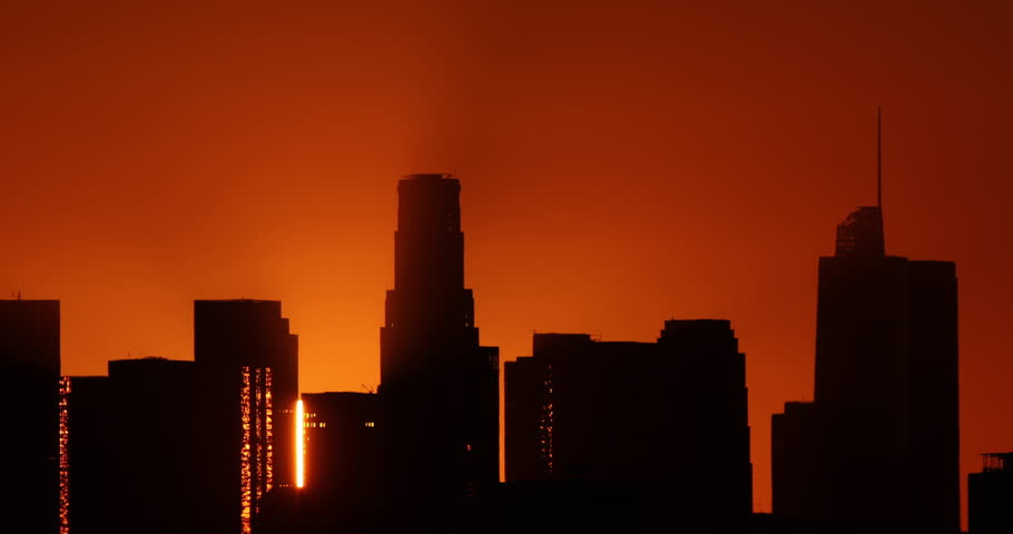 Time lapse of the sun rising from behind the skyscrapers of downtown Los Angeles. | Shutterstock HD Video #25296344
