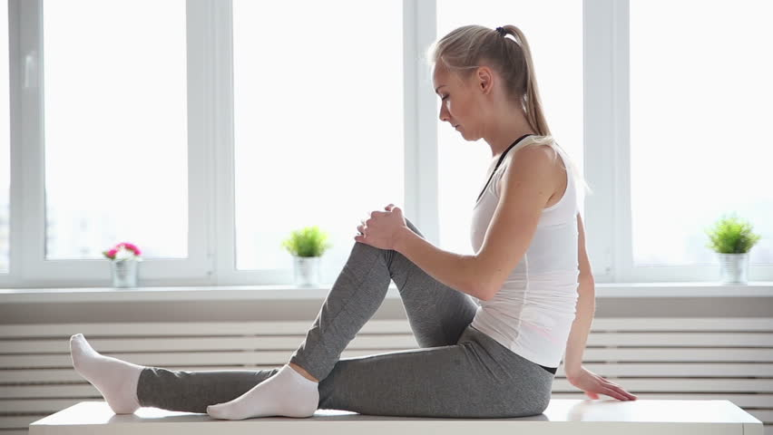 Fitness, sport, power-lifting and people concept - stretching young woman in the gym | Shutterstock HD Video #25334756