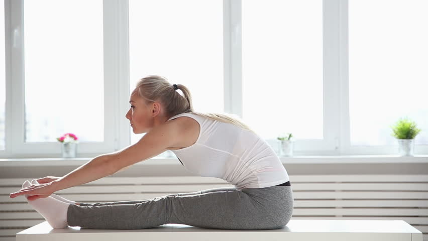 Fitness, sport, power-lifting and people concept - stretching young woman in the gym | Shutterstock HD Video #25334765