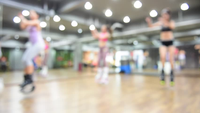 Blurred of an unidentified group of woman  doing exercises fitness with kangoo shoes.The best background for use. | Shutterstock HD Video #25335071