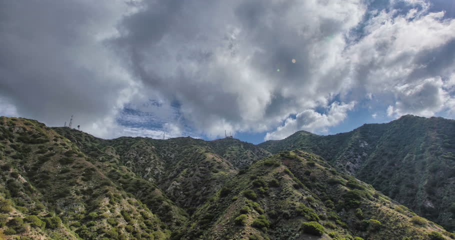 4K HDR Time-lapse of Burbank - mountaintop overlooking Burbank with blue sky, billowing white clouds and green Verdugo mountain range.  | Shutterstock HD Video #25340606