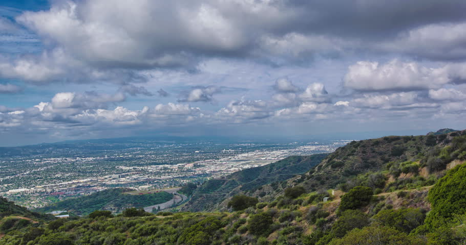 4K HDR Time-lapse of Burbank - from mountaintop overlooking City of Burbank and Bob Hope Airport. Blue sky with billowing white clouds and green Verdugo mountains.  | Shutterstock HD Video #25340624