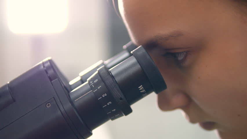 School girl looking into microscope. Close-up. | Shutterstock HD Video #25344368
