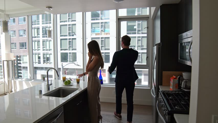 Business couple in the modern home talking on phone, busy lifestyle / Shot on Red Epic | Shutterstock HD Video #25344773