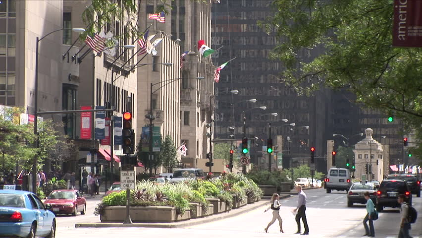 Chicago, IL - CIRCA September 2007: Pedestrians cross a busy street during a very bright and sunny day | Shutterstock HD Video #2535452
