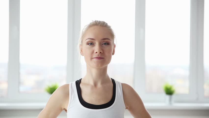 Fitness, sport, power-lifting and people concept - stretching young woman in the gym closeup | Shutterstock HD Video #25356500