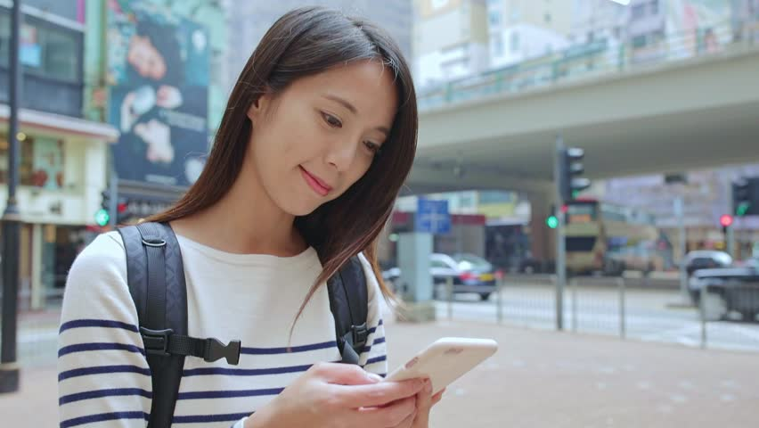 Woman sending sms on mobile phone | Shutterstock HD Video #25384445