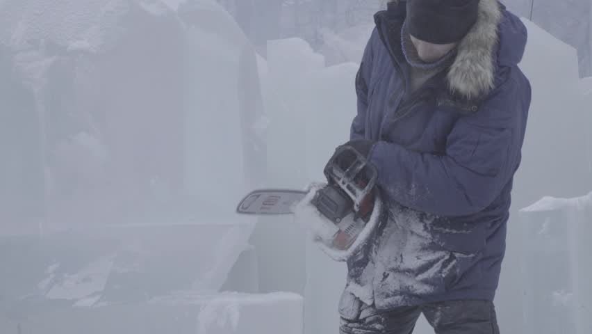 View of sculptor carving ice. Movement. Cut ice with a chainsaw. Cut and make snow sculpture. Chopping iced water with an axe. Ice Sculpture Carving. V-LOG | Shutterstock HD Video #25423001