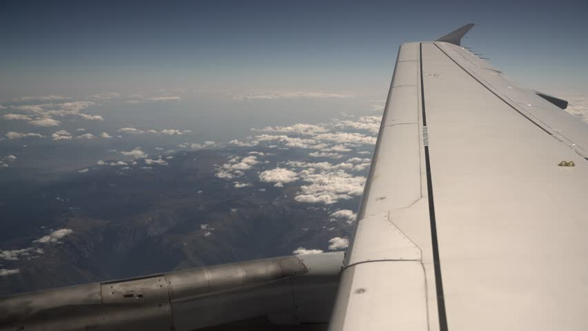 Wing of a flying aircraft over mountains, 4K Aerial Video Footage #25460333