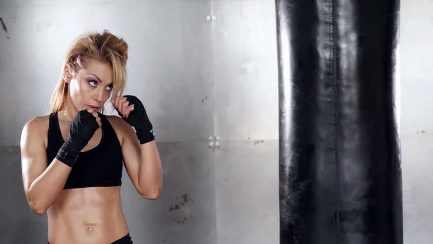 A beautiful and fit woman has a kickboxing training. Sport, health, concept. | Shutterstock HD Video #25485587