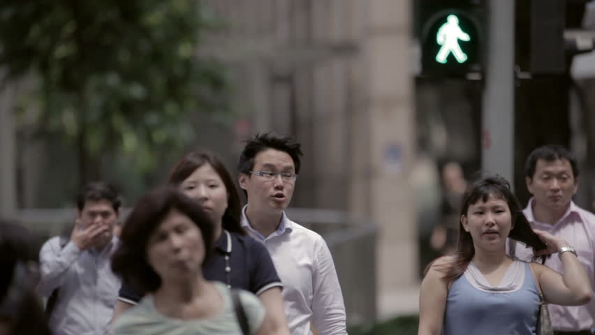 SINGAPORE - JUNE 14: People walking down street on June 14, 2012 in Singapore.