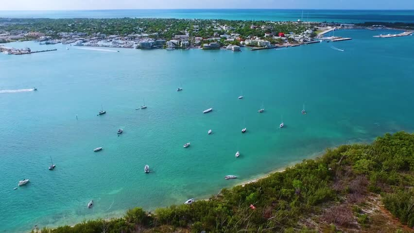 Sailboats Anchored Off Shore Near Island | Shutterstock HD Video #25540847