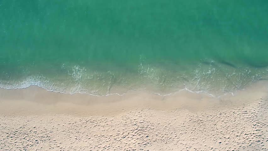Small Waves Lapping Beach Sand | Shutterstock HD Video #25552565