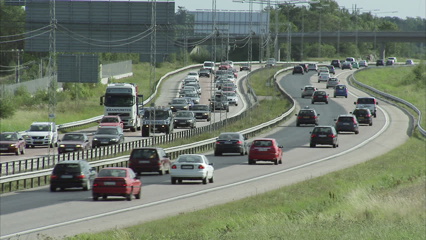 STOCKHOLM, SWEDEN - SEPTEMBER 2008: Cars driving on motorway, Stockholm, Sweden. | Shutterstock HD Video #2559374