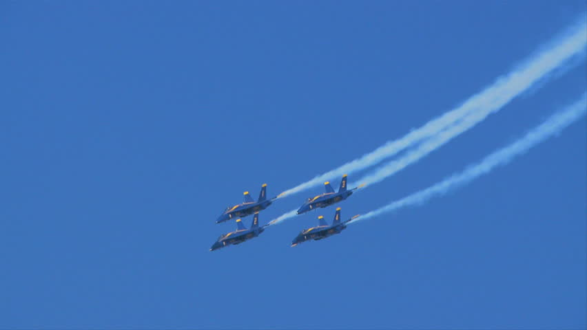 QUONSET, RHODE ISLAND - CIRCA JUNE 2012: Blue Angels - 13 four jets in formation -- then break away and go in different directions
