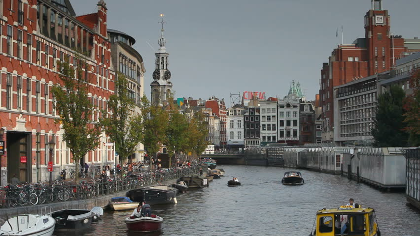 HOLLAND, NETHERLANDS - CIRCA MAY 2011: Boats on canal at sunset, Amsterdam. - HD stock footage clip